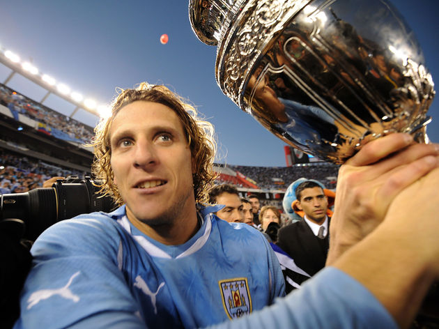 Uruguay's Diego Forlan holds the Copa Am