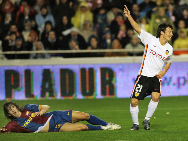 Valencia's David Silva (R) celebrates hi...