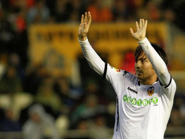 Valencia's midfielder David Silva celebr
