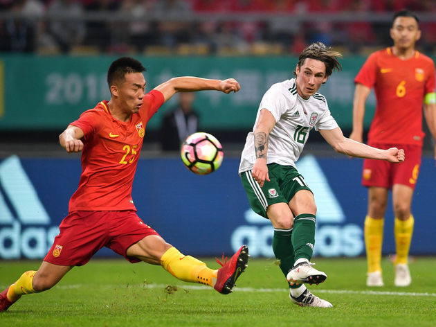 Wales competes against China during China Cup International Football Championship