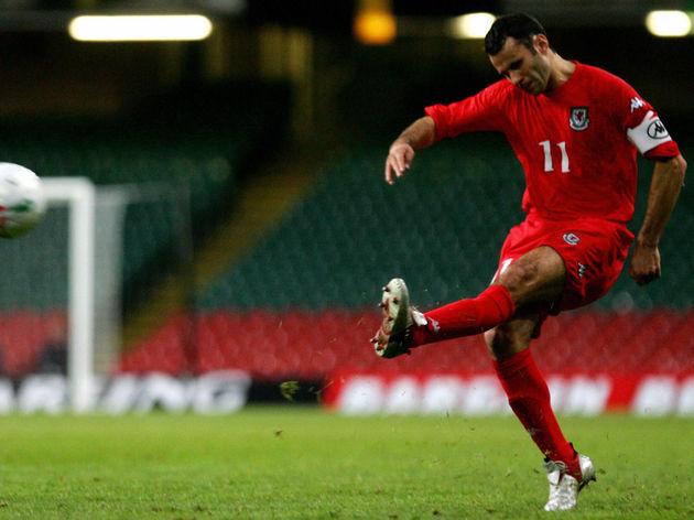 Wales's Captain Ryan Giggs has a shot at