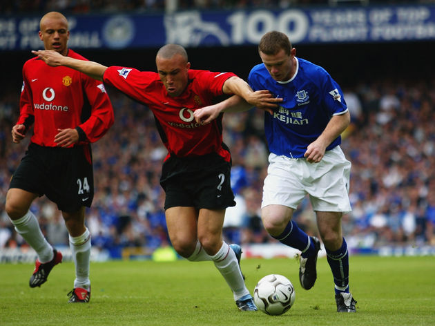 Wayne Rooney of Everton and Mikael Silvestre of Manchester United