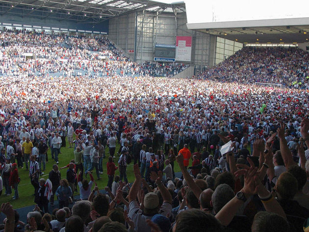 West Bromwich Albion fans celebrate on t