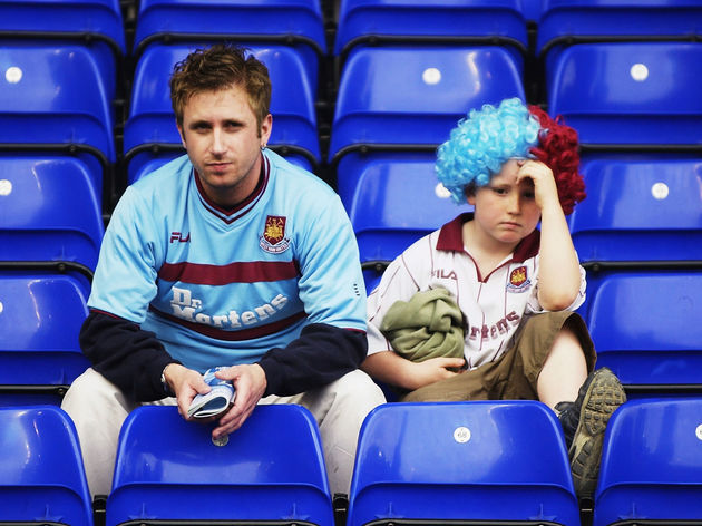 West Ham United fans look dejected after their team are relegated