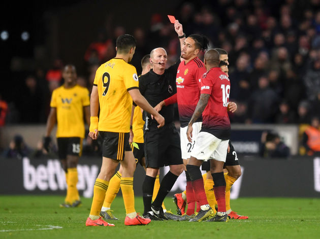 Ashley Young,Mike Dean