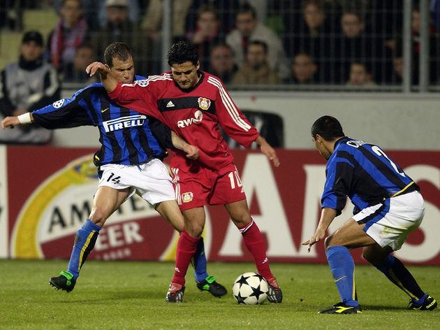 Yildiray Basturk of Bayer Leverkusen and Ivan Cordoba and Luigi Di Biagio of Inter Milan