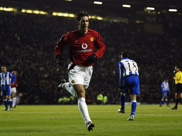 Ruud Van Nistelrooy of Manchester United celebrates after scoring his first goal