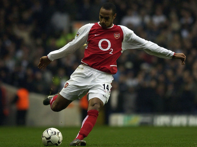 Thierry Henry of Arsenal prepares to strike the ball...