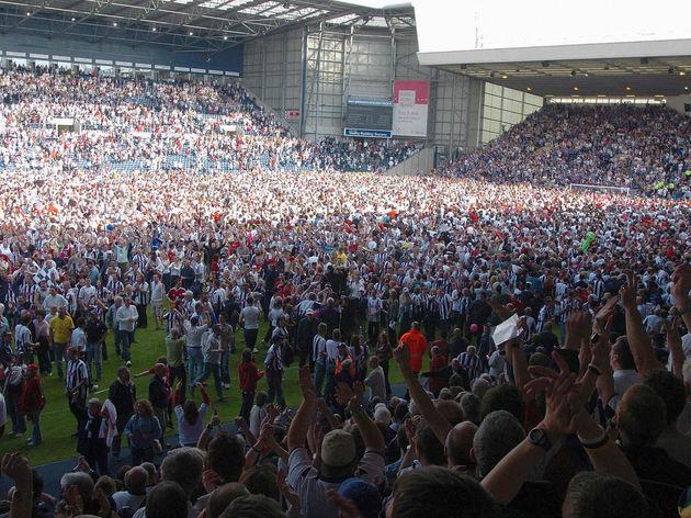 West Bromwich Albion fans celebrate on t